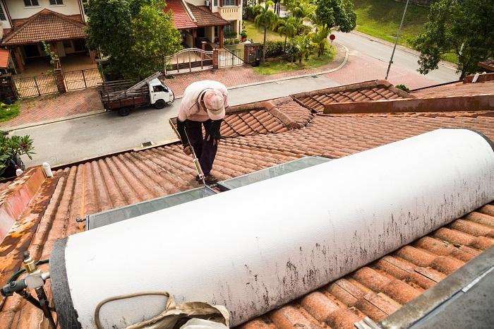 woker fixing solar hot water system